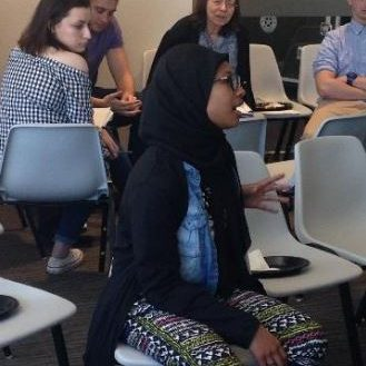 Student participating in Global Cafe discussion