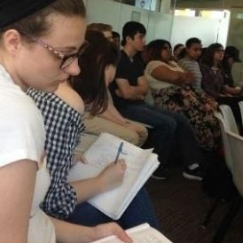 Student Taking notes at Global Cafe Event